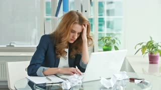 Frustrated young woman trying to straighten out business matters but � no good