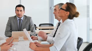 Furious team leader being disappointed with the work of his colleagues