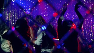 Jolly crowd going all out dancing at nightclub