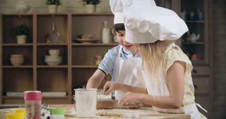 Little siblings learning to bake together