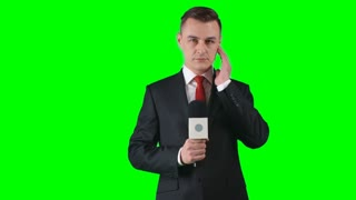 Lockdown of man in formal suit standing against green screen background gesticulating and talking passionately into microphone