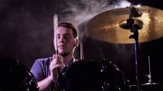 Low angled close up of cymbalist playing out of steam