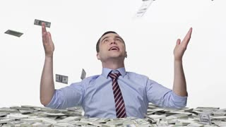 Man welded by money, trying to catch the falling notes