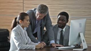Mature businessman mentoring his interns