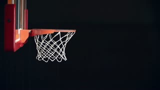 Side view of basketball player scoring the basket in jump shot