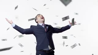 Slow motion of dollars falling on man in jacket