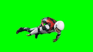Slow motion shot of skydiver in full parachuting gear, white helmet, jumpsuit and harness, flying relaxed in turning free fall, looking down, extreme sports chroma key against green background