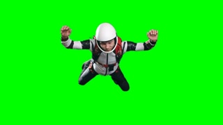 Slow motion video of calm professional skydiver performing free fall, counting meters till parachute opening time and looking at altimeter on his wrist against green background, chroma key