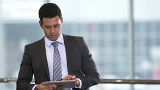 Successful entrepreneur planning his business activity with the help of a modern device