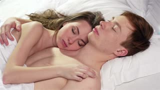 Tender couple sleeping in each other�s arms