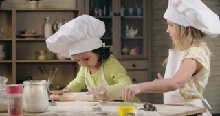 Two lovely little girls baking together