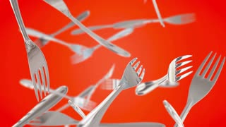 Digitally generated animation with metal forks flying up on orange background