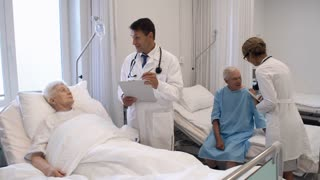 Healthcare professionals visiting elderly patients in comfortable hospital ward