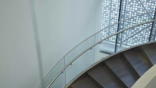 High angle view of businessmen and businesswomen walking up and down the stairs in office building