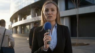 Medium shot of female Caucasian news reporter making reportage from the scene