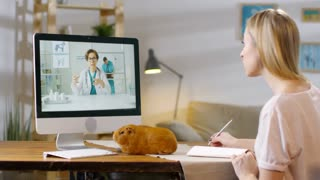 Little boy using tablet for talking via video call while sitting at desk at  home Stock Video Footage - Storyblocks Video