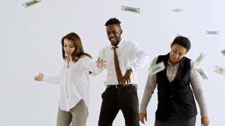 Studio shot of happy multi-ethnic businesspeople laughing and dancing isolated on white background as money falling on them from above