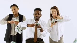 Studio shot of rich Caucasian and black businesspeople making it rain money isolated on light background