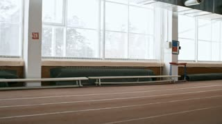 Tracking of determined sportsman with prosthetic leg sprinting on indoor track during practice