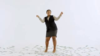 Wide studio shot of happy black businesswoman laughing and dancing isolated on white background as money falling on her from above