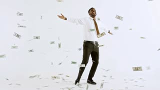 Wide studio shot with white background: happy black businessman in shirt and necktie laughing and celebrating as money falling on him from above
