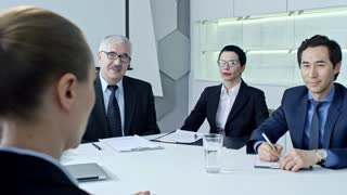 Woman answering questions of HR managers while having job interview in the office