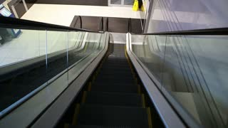 View of escalator stairway moving downwards