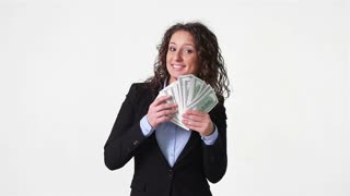 Wealthy young woman throwing her money about
