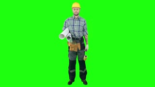 Workman in hardhat and uniform standing on green screen background, holding blueprint and roller and smiling