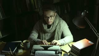 Writer typing on printing-press