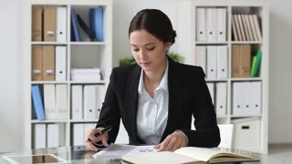 Young lady being busy analyzing financial reports