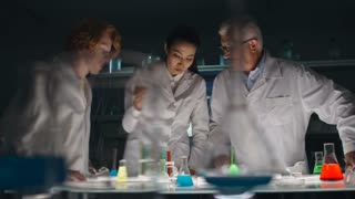 Young man, woman and senior chemist working together in laboratory at night
