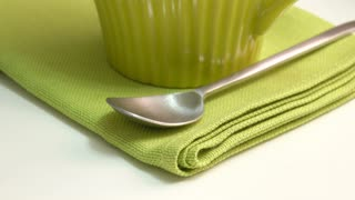 Green tea in strainer. Close up film clip with sliding motion.