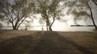 Calm and beautiful nature scene with bicycle and lake