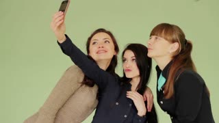 Group of girls made photos on mobile phones