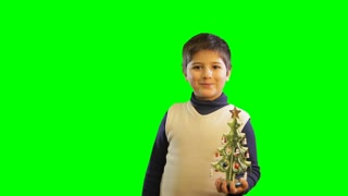 boy with toy christmas tree on green screen background