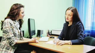 business woman talking at table