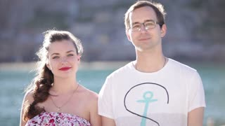 Man and woman smile at you at sunny day