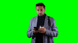 Man in suit a use mobile and hold coffee cup. Green screen, footage.