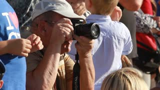 photographer take a shots in crowd