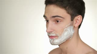A handsome young man shave