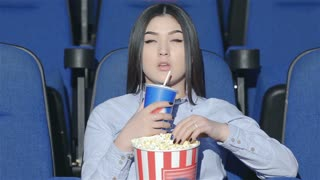 Asian woman alone in the movie theater