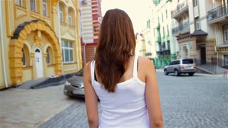 Attractive woman walking in a beautiful town