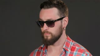 Bearded guy chews gum