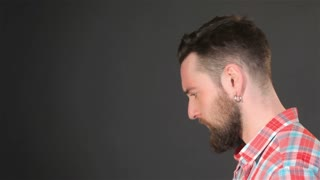 Bearded guy ponders a problem