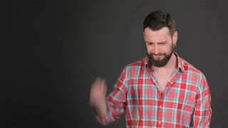 Bearded man expresses bother