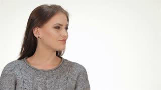 Brunette girl makes a gesture shh