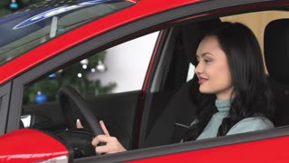 Buyer woman doing thumps-up in car