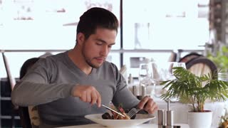 Casual dressed man eat salad