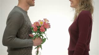 Close up guy presents girl flowers